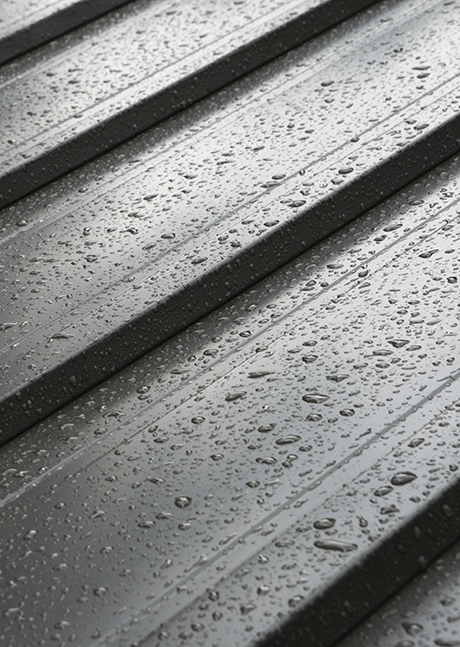 dark metal roof detail with raindrops